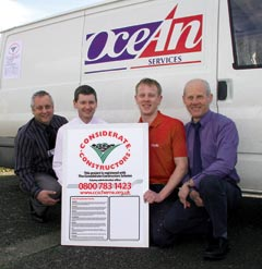 Employees of Ocean housing Group with the CCS poster