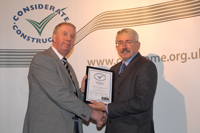 Company collecting award